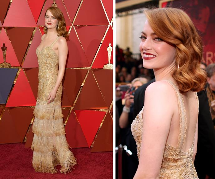 Emma Stone channels 1920s glamour in this Oscar-inspired gold design. **Watch the hilarious moment JT photobombs Emma**