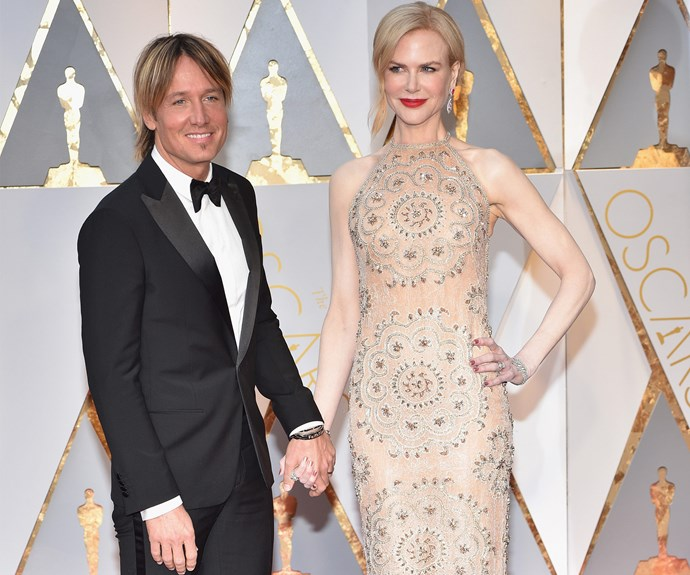 Hand-in-hand with her leading man, kuzzle king, Keith Urban