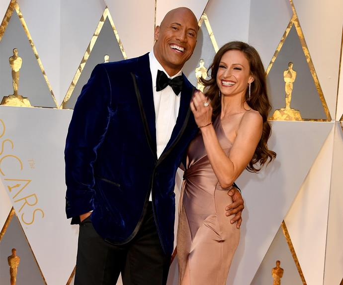 Matching smiles for Dwayne Johnson and partner Lauren Hashian.