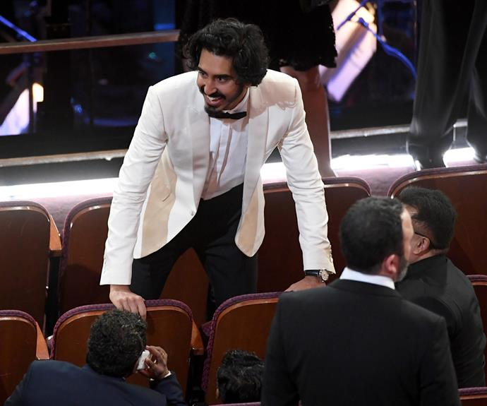 Dev Patel find his seat.
