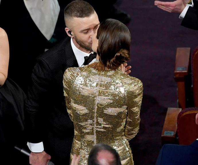 Proud wife Jessica Biel plants a kiss on JT shortly after his performance.