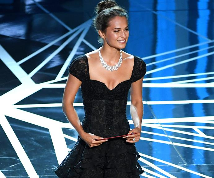 Alicia Vikander takes to the stage to present the Best Supporting Actor gong.