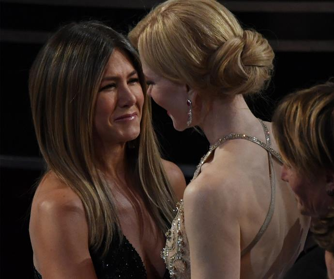 Jennifer Aniston and Nicole Kidman, who starred together in the 2011 flick *Just Go With It*, share a warm embrace as they bump into each other during the ceremony.
