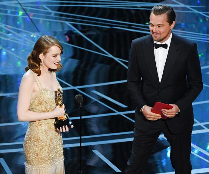 Leo looks on proudly as Emma takes to the stage.