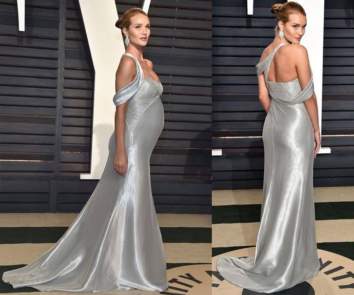 A pregnant Rosie Huntington-Whiteley debuts her bump in stunning silver.