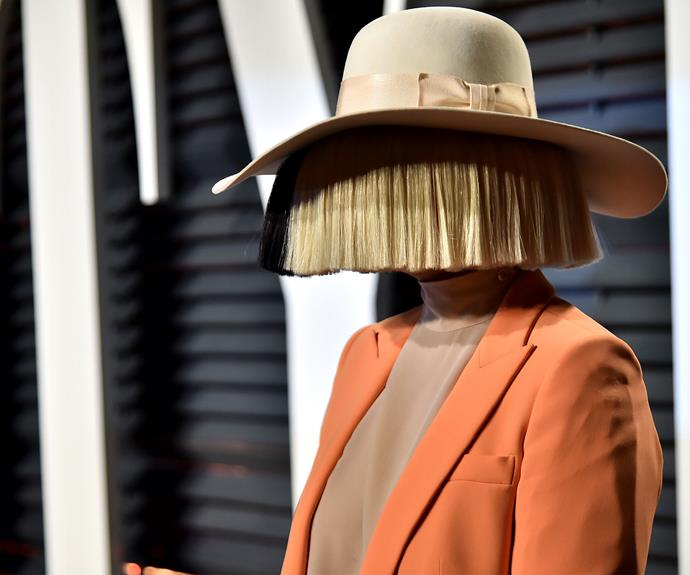 Sia goes incognito with this bold look.