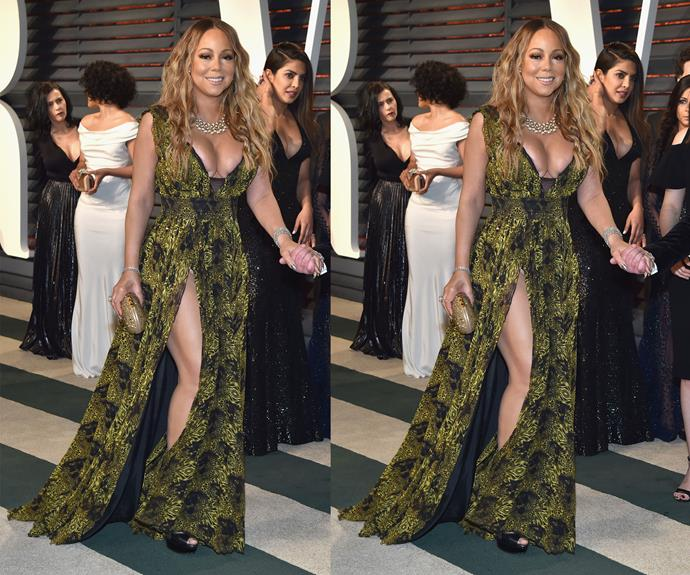 Mariah Carey arrives, looking her most fabulous self in a floor-length green gown and her hair in beachy, golden waves.