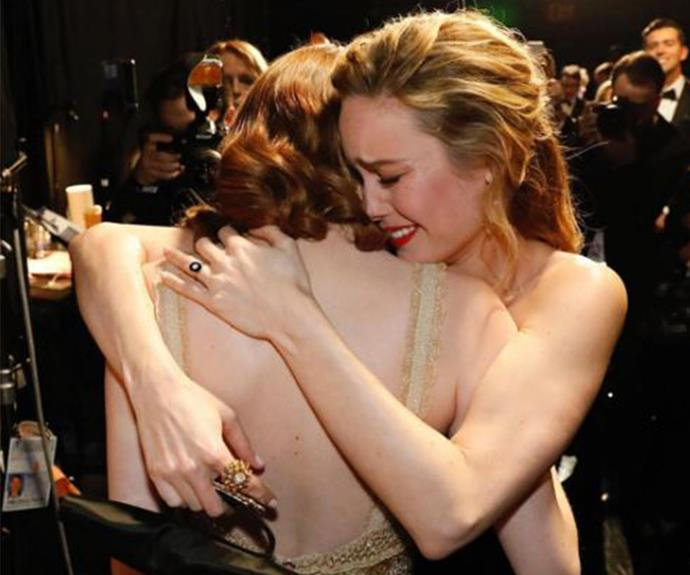 "The moment last year's Best Lead Actress, Brie Larson, embraces her friend and 2017 winner, Emma Stone. ""You know what's better than winning? Watching your friends win,"" the *Room* beauty penned next to this incredible shot."