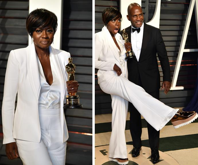 Best Supporting Actress winner Viola Davis' flashes her stunning gold platform shoes as she makes a glorious entrance to the *Vanity Fair* after party.