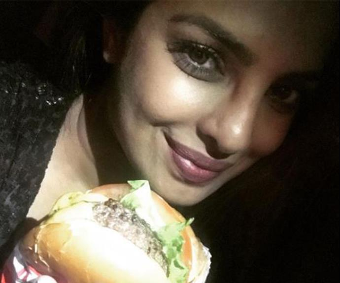 What's an after party without a little indulgence? Priyanka Chopra tucks into a mouth-watering In-N-Out burger.