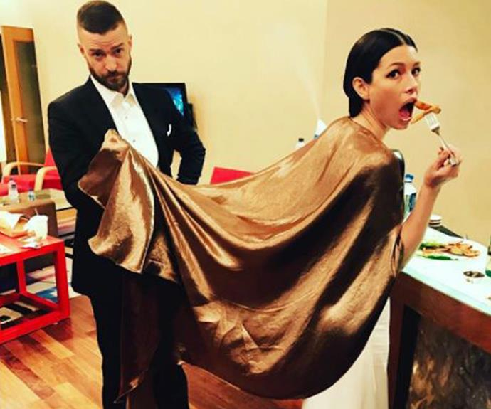 "What a man, JT holds Jess' cape as she tucks into some pre-party fuel. ""Post Oscars. Pre party. Baby daddy duty,"" the actress joked."