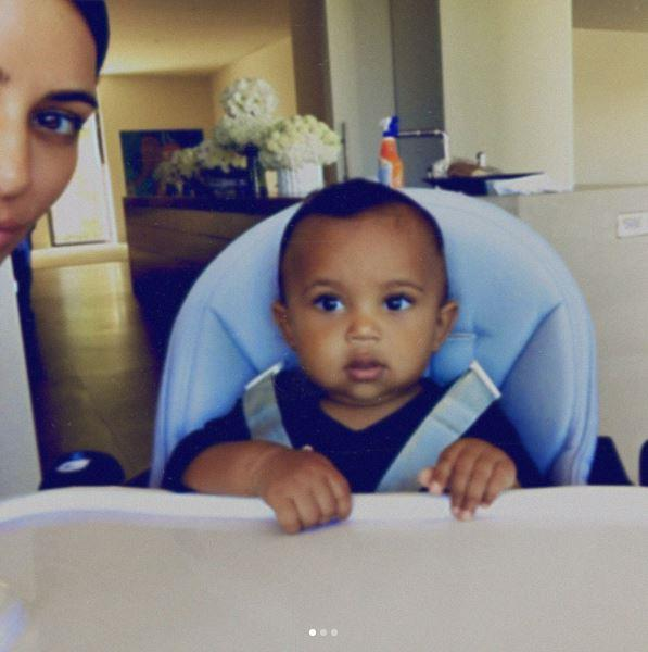 "Kim also posted a series of adorable photos, captioned ""Me and my Sainty boo a few months ago."""