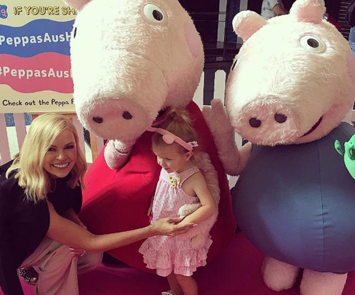 "Pretty in pink and topped off with a pair of piggy ears, Sonia Kruger's darling daughter Maggie enjoys a VIP moment, meeting the one-and-only Peppa Pig at the Australian premiere of [*Peppa's Australian Holiday*](http://www.nowtolove.com.au/parenting/family/peppa-pig-is-heading-on-an-australian-adventure-17010|target=""_blank"")."
