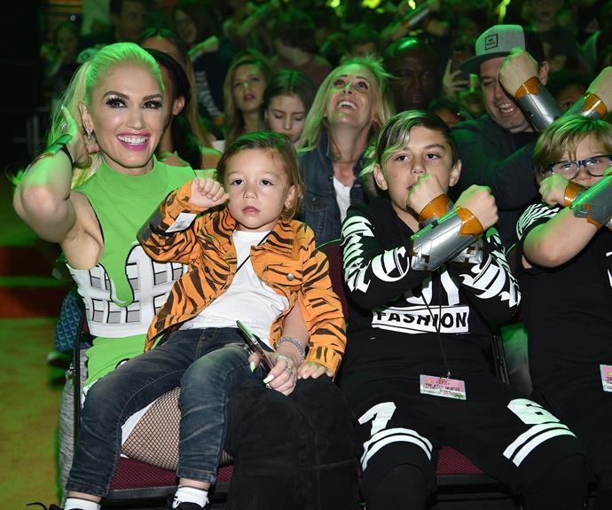 Gwen Stefani and her three sons take in the show from the front row.