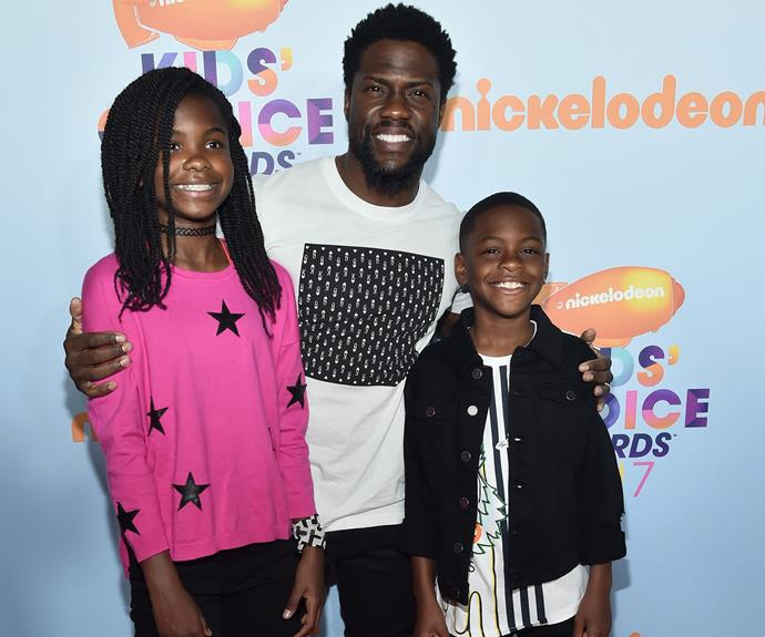 Kevin Hart beams as he stands proudly by daughter Heaven, 11, and eight-year-old son Hendrix.