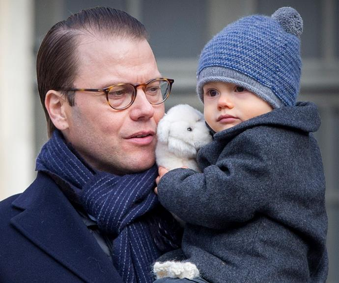 The couple's youngest preferred to be rugged up in his papa's arms.