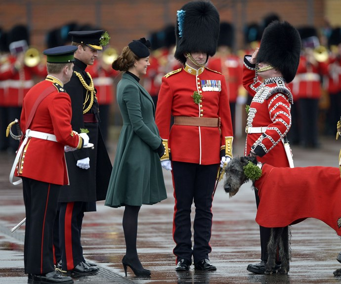 Duchess Catherine braved the rain to present the Irish Shamrocks in 2013. The Duchess wore a military-inspired Emilia Wickstead dress coat, and was five months pregnant at the time with Prince George.