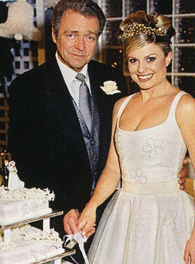 **Donald & Marilyn (1996):** Considering all the other shocking relationships in the Bay, this one is relatively tame. But, it did cause a stir when beautician Marilyn (Emily Symons) began dating school principal Donald (Norman Coburn), who was almost twice her age. The pair became close when Marilyn was a mature-age student at the school. Their friendship later turned to romance, and they got married. Sadly, it all ended soon after their son died.