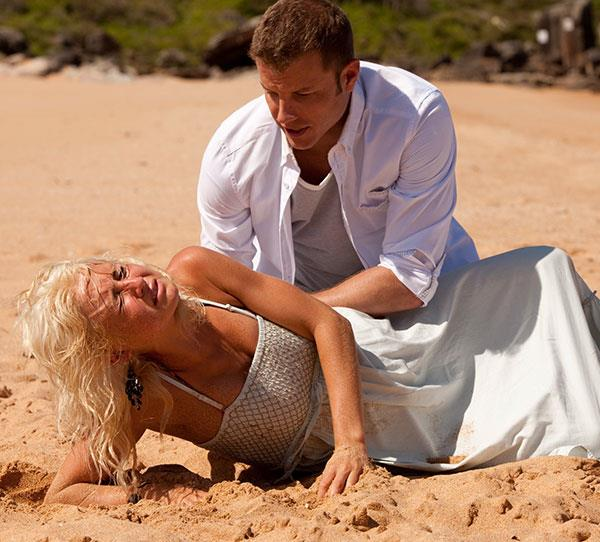 **Nicole – Tessa James 2011**  Nicole and Angelo (Luke Jacobz) were strolling along a deserted beach when Nicole went into labour. With a helping hand from Dr Sid (Robert Mammone), who was on the phone, Angelo succesfully delivered Nicole's baby boy.