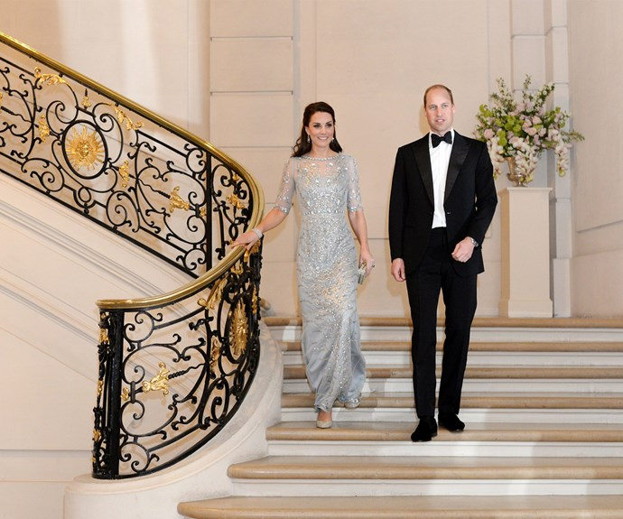 **March:** To celebrate their stay in Paris, the royal couple were the guests of honour at a dinner thrown at the British Embassy. The Duchess wore a shimmering, pale blue Jenny Packham dress.