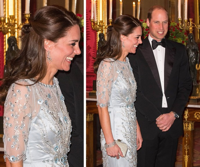 The gown showed off Kate's flair for fashion, featuring pretty sheer sleeve and dainty floral embellishment.