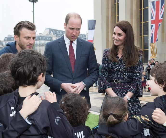 """Will and Kate stopped by """"Les Voisins in Action"""" (or """"Neighbors in Action"""") at the Trocadéro, where they met with a group of young people from both France and UK."""
