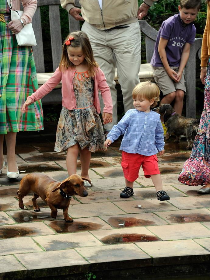 Mary and Frederik's kids Princess Isabella and Prince Vincent (pictured again at Gråsten) make us, too, want to abandon all our cares at the sight of a Dachshund.