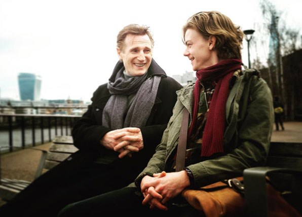 Liam Neeson and Thomas Brodie-Sangster filming the Love Actually sequel.