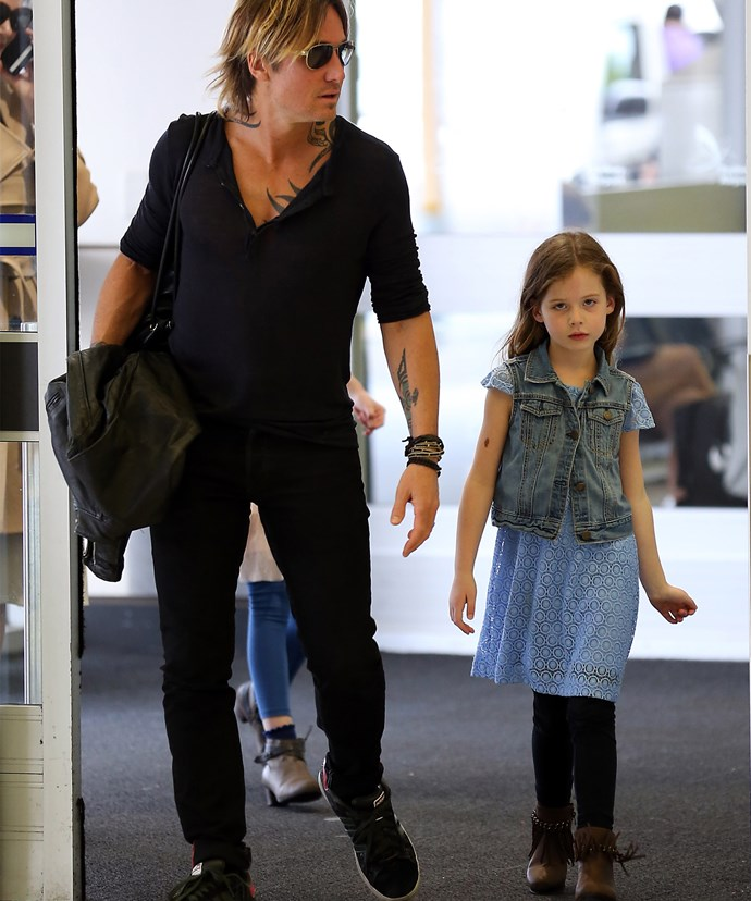 Faith strolls beside her daddy.