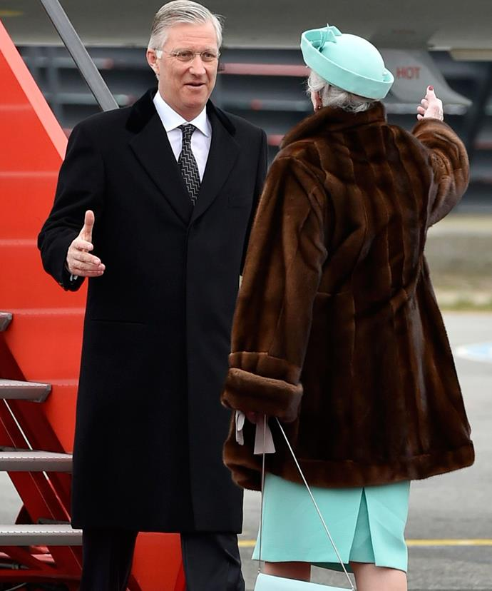 Queen Margrethe greets her old friend, the King of Belgium.