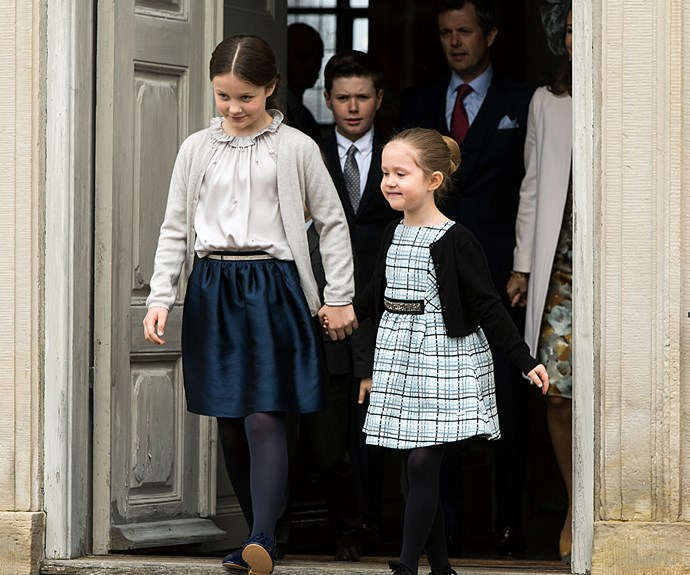Princess Isabella and Princess Josephine held hands as they skipped out of the service.