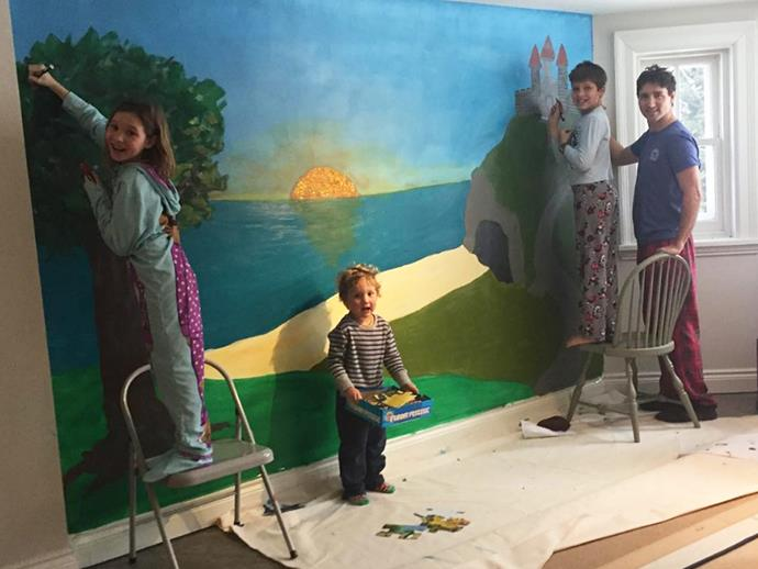 "Justin Trudeau have a painting pyjama party with his kiddies is the cutest thing you'll see all week/month/year. ""What did we do after staring at the beige basement walls on a rainy day? A mural!!!! Nothing better than art and colours to wake up our spirits. With your brushes children!,"" shared wife Sophie Grégoire beside this adorable snap."