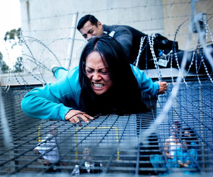 **Kim scales the fence:** Kim scaled the fence while under the influence of drugs. She ended up in hospital due to horrific injuries from the barbed wire.