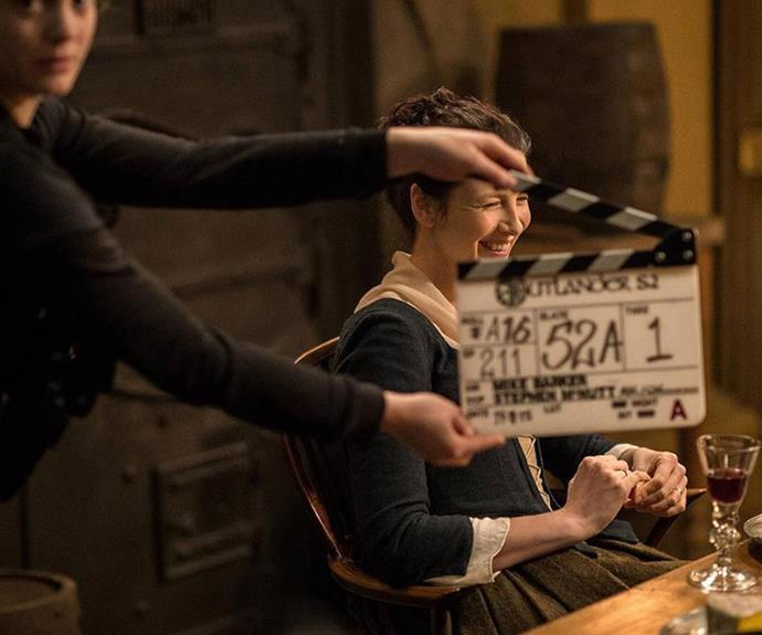 Caught! Caitriona giggling before a scene.
