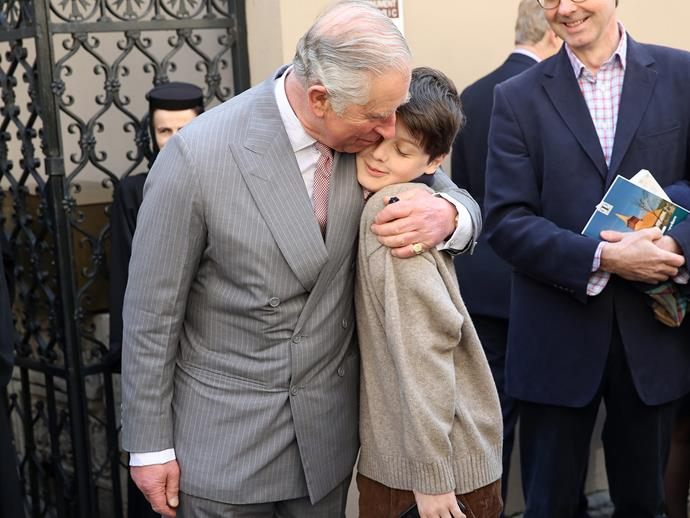In a rare display, Prince Charles breaks the royal protocol by sharing a genuine bear hug with an 11 year old schoolboy during a European visit to Romania.