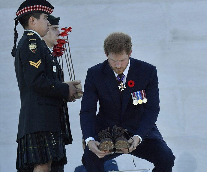 Prince Harry pays his respects.