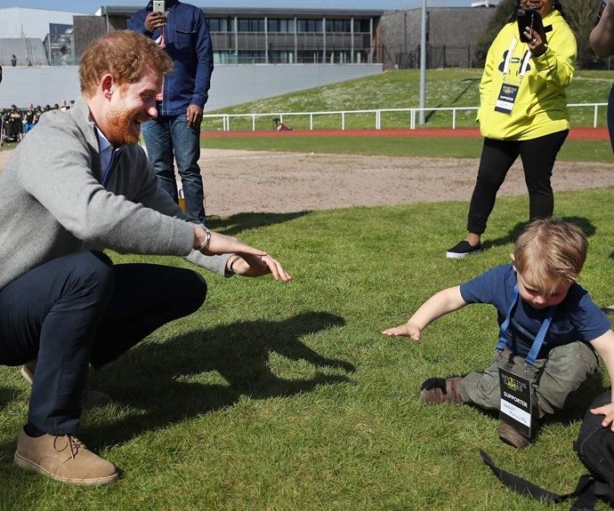 The two-year-old, who shares the same name as the Prince, took a tumble as he energetically met Captain Wales' high-five with a fist bump.