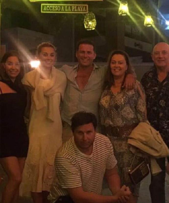 Karl looks cosy with Jasmine and her family as they celebrate her brother's 30th. (Pic/Facebook)