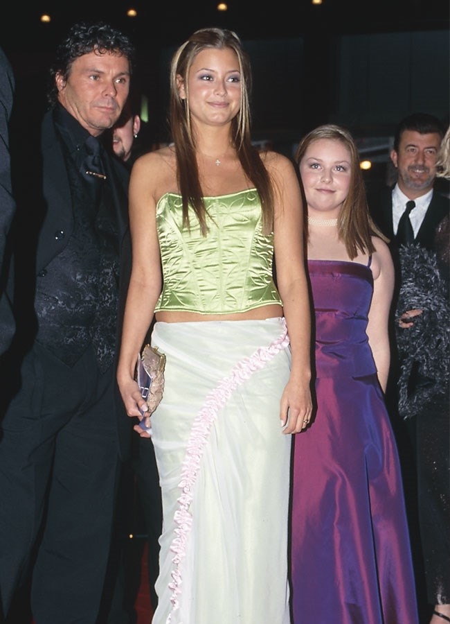 A baby-faced Holly Valance went for a lime two-piece at the 2003 Logies.