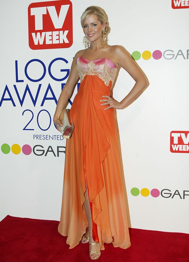 Television presenter Sophie Falkiner wore a tropical orange gown at the 2003 Logies.