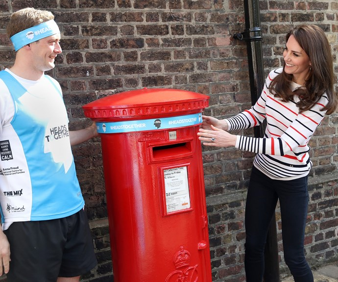 The 35-year-old and runner Alex Stanley wrap a Heads Together headband around the post box at the palace because why not? At the event, Catherine launched 70 Royal Mail boxes with the decorations on them.