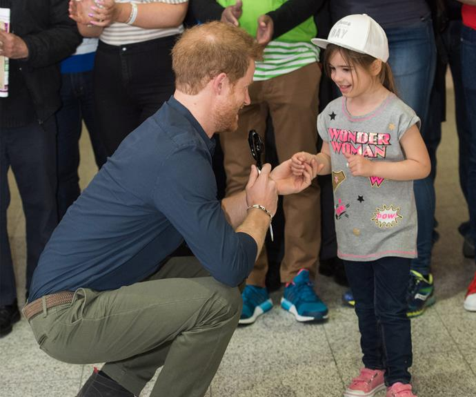 Harry accidentally forgot to take the scissors off the young girl! When he realised, he quickly grabbed them back. **Watch the sweet moment in the next slide!**