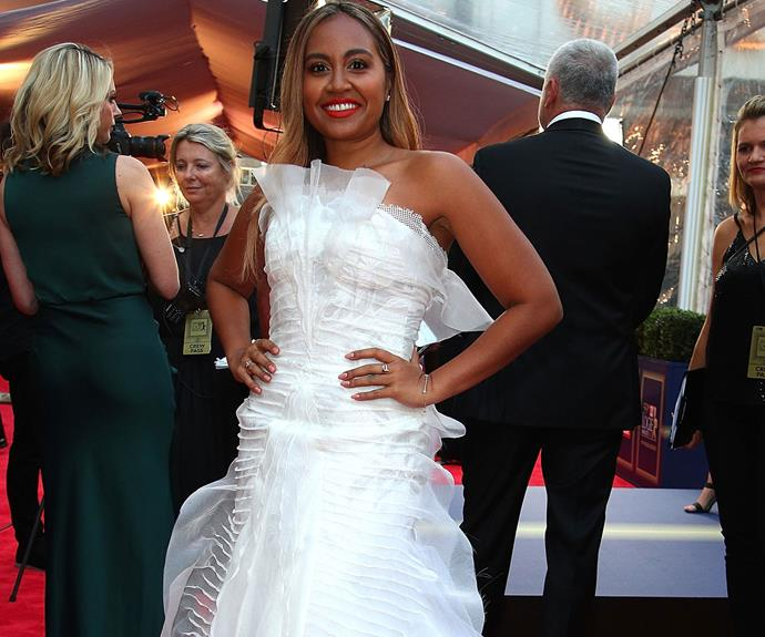 Jessica Mauboy steps out in a ruffled white frock and a bright lip - we're obsessed!