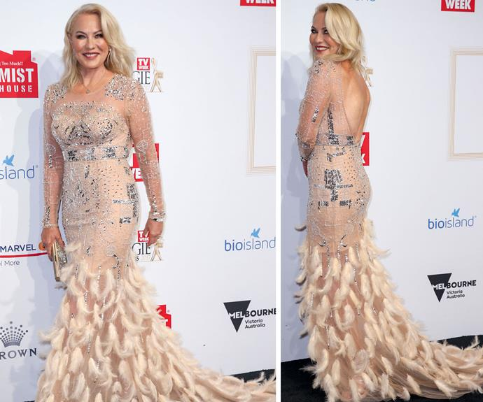 Kerri-Anne Kennerley shines in this nude design with a feathered train.