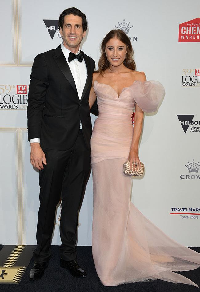 Radio funnyman Andy Lee and his model girlfriend Rebecca Harding, who looked every inch the princess in her blush pink Cappellazzo Couture gown.