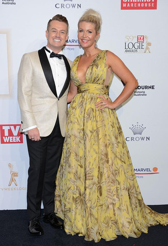 """*Family Feud* host Grant Denyer and his wife Cheryl. Grant paid tribute to his wife on Instagram, """"My absolute highlight? + my wife. I couldn't walk 2 weeks ago, so walking the red carpet arm in arm was a such magical moment. I couldn't have made it to the #Loiges at all if it wasn't for her."""""""