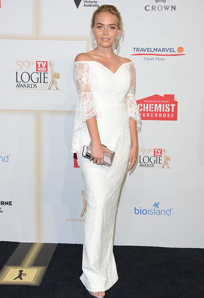 Lilly Van Der Meer glowed in her white Jadore lace gown.