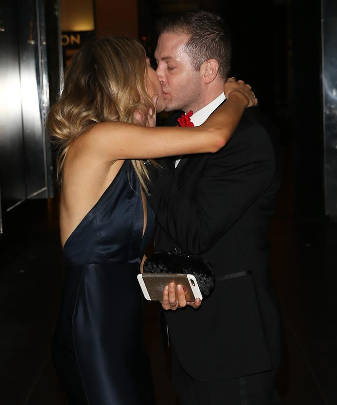 She was snapped kissing reporter John Caldwell.