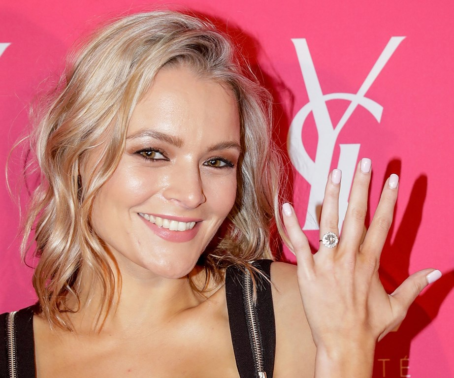 Alexandra showing off her flashy engagement ring.