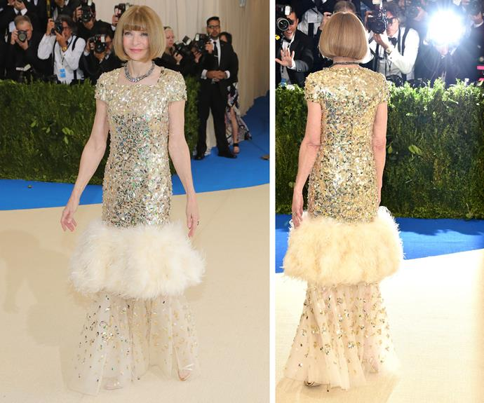 And we're off! The essence of all things *Vogue* and the publication's editor-in-chief, Anna Wintour, stepped out on the yellow carpet in this sparkling gold number.
